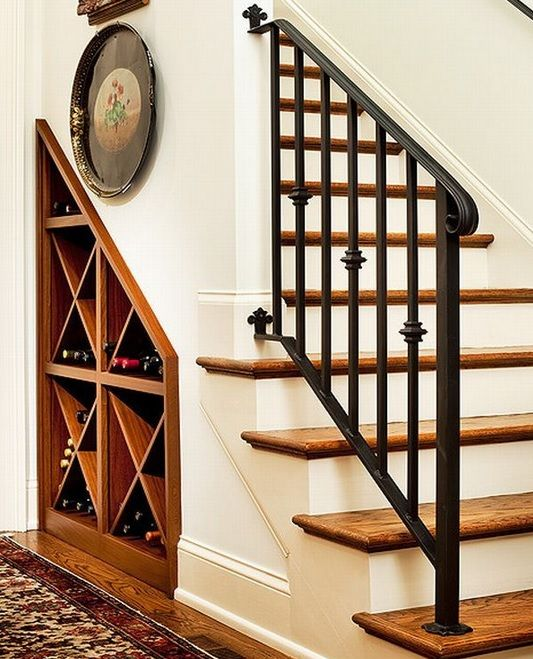 a built in wine storage space under the stairs will save much space and your wine will be at hand