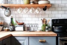 19 a grey kitchen with a white tile backsplash and butcher block countertops for a chic look