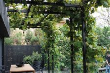 19 a large metal frame covered with lush greenery looks modern and refreshes the dark space