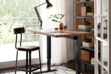 19 a stylish industrial desk of darkened metal and a wooden countertop plus a matching tall stool