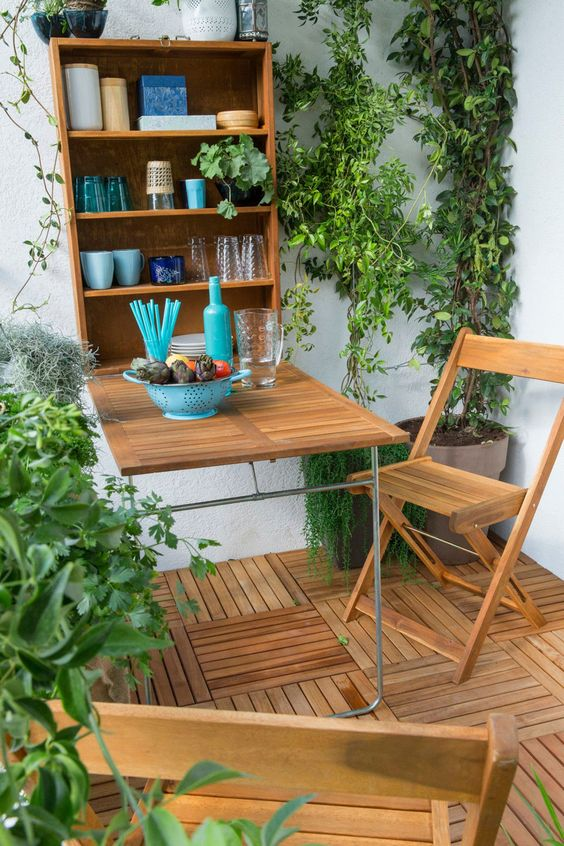 a balcony with a murphy's bar and chairs plus a lot of greenery, you won't need more