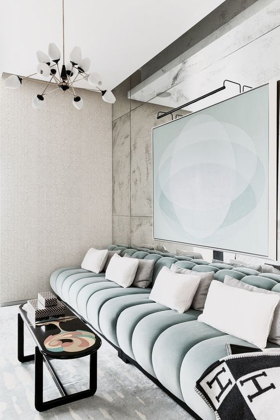 a contemporary TV or cinema room with a luxurious aqua velvet banquette