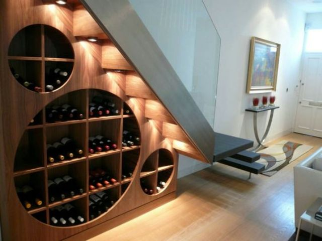 a creative and cool modern wine rack under the stairs with additional lights to accent it