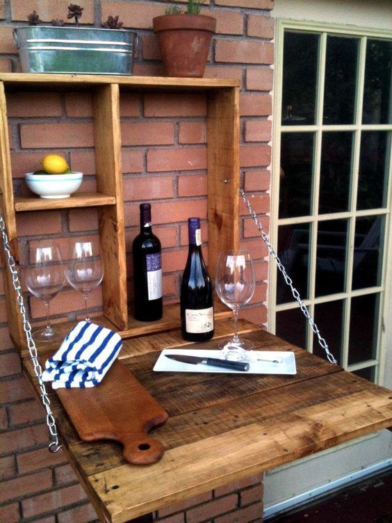 a foldable hanging bar won't take much space in your outdoor zone and can be hidden any time