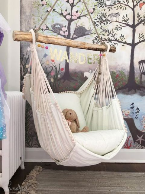 a hammock chair with cushions is a great piece for a kids' room to make it welcoming and dreamy