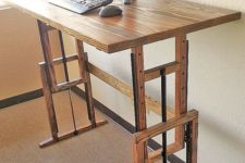 21 an adjustable wooden desk is a great idea to sit and stand anytime you want