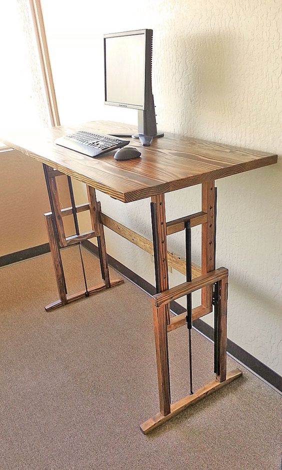 an adjustable wooden desk is a great idea to sit and stand anytime you want