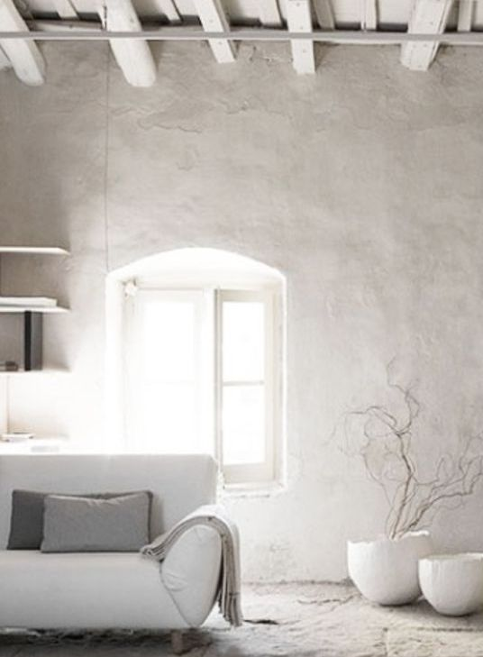 even the most neutral space will look bolder and more interesting with a grey plaster wall like this one