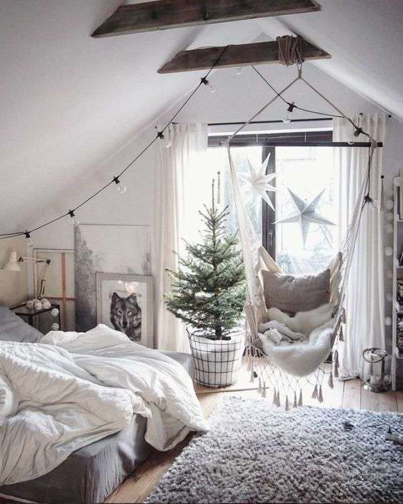 a hammock chair with tassels adds coziness and a relaxed feel to the bedroom