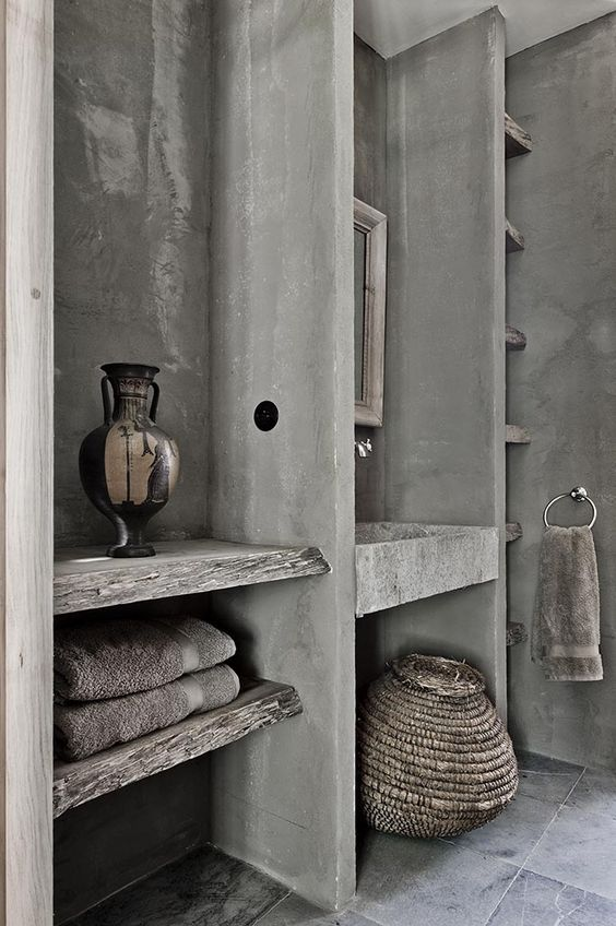 grey concrete with wood makes the bathroom interesting and rough, it stands out