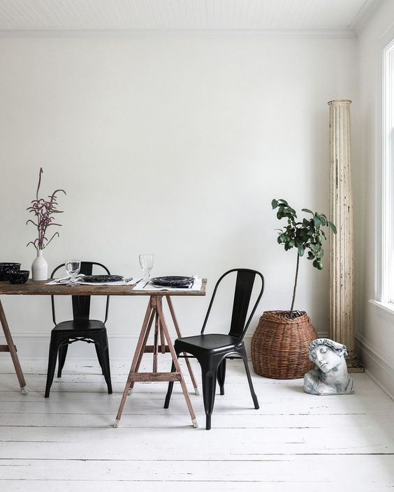 a dining space is fully uncluttered and features much negative space for a peaceful feel