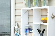 23 a folding outdoor bar provides enough storage and bar counter space