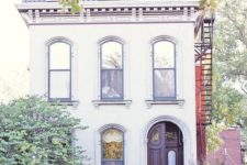 23 a small footprint yet tall home with a mansard roof, which becomes another floor for living