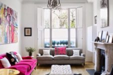 23 an eclectic space with a magenta sofa and a matching bright artwork for a colorful statement