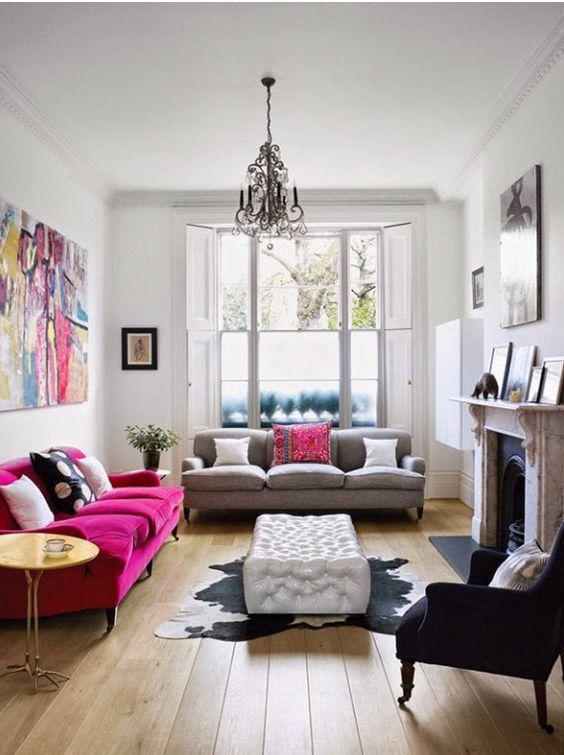 an eclectic space with a magenta sofa and a matching bright artwork for a colorful statement