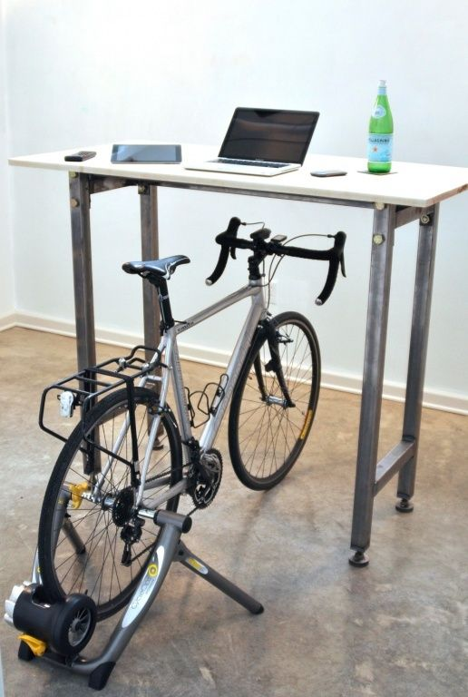 this desk allows you to kill two birds with one stone - get your desk job done and keep fit