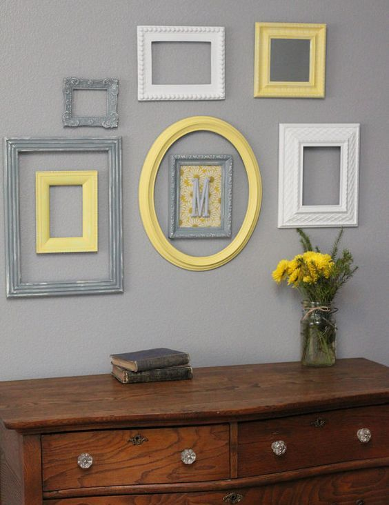 vintage rustic decor is highlighted with a group of frames in yellow, grey and white plus a monogram