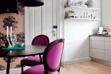 24 a chic dining space with elegant magenta chairs and floral wallpaper to separate it from the kitchen