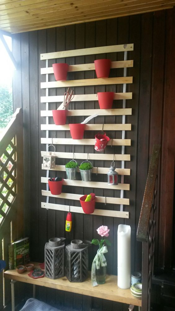 IKEA Lattenrost turned into a a cool wall-mounted planter holder, which is ideal for small spaces