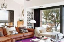 25 a bright and cozy mid-century modern living room with a magenta rug for a colorful touch