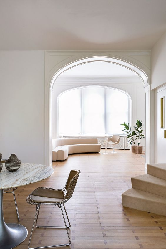 a modern light-colored space with much negative space looks very spacious and welcoming