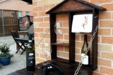 25 a small dark-stained wooden pallet bar attached to the wall is all you need