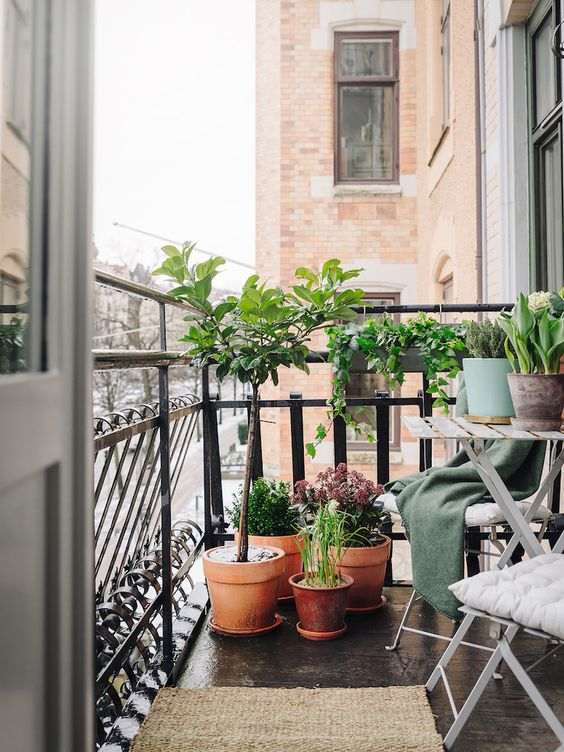 folding furniture and potted greenery are all you need for a small balcony