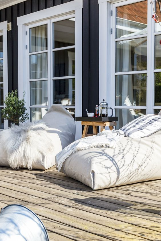 large bean bag chairs to use them instead of loungers in your outdoor space is a great and creative idea