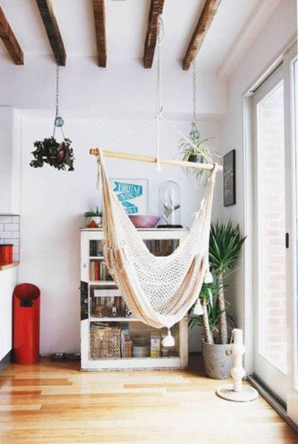 hang a hammock chair by the window to enjoy the views while swinging in the chair and relaxing