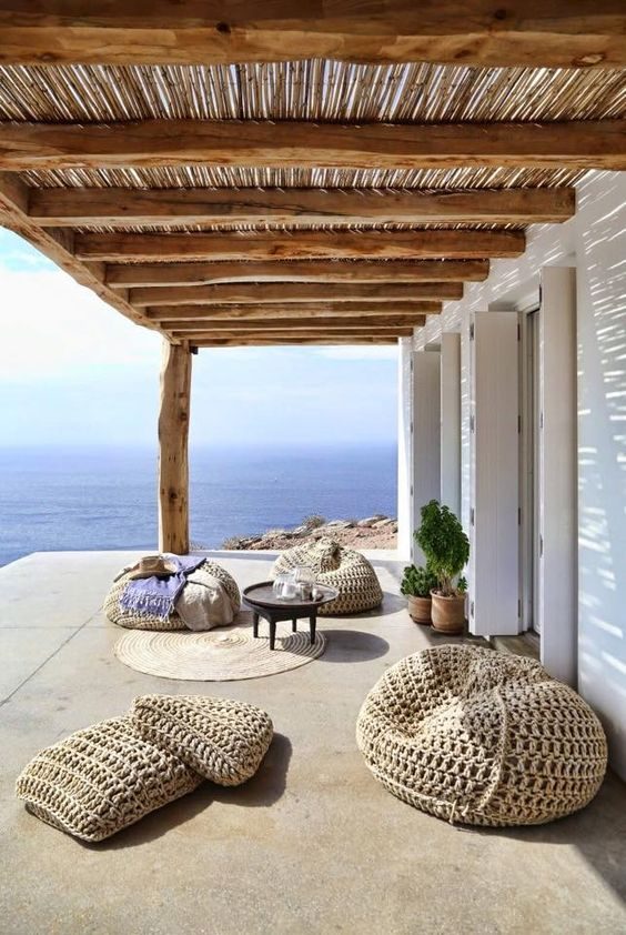 super cool straw bean bag chairs and floor pillows to create a chic Mediterrnean lounge outdoors