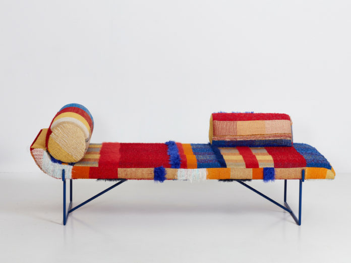 Loom is a colorful and bold chaise longue with a throw done with textural upholstery inspired by the 1950s and 1960s