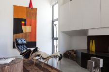 01 This gorgeous modern industrial home used to be a factory built in the 1960s and it retained its industrial origin getting softer modern touches