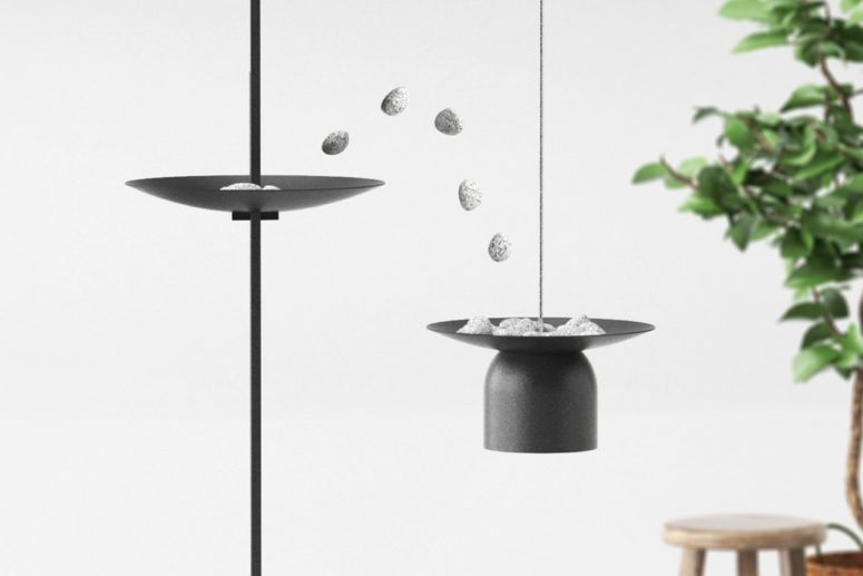 This interactive lamp is a creative piece with marble stones that are used for adjusting its height