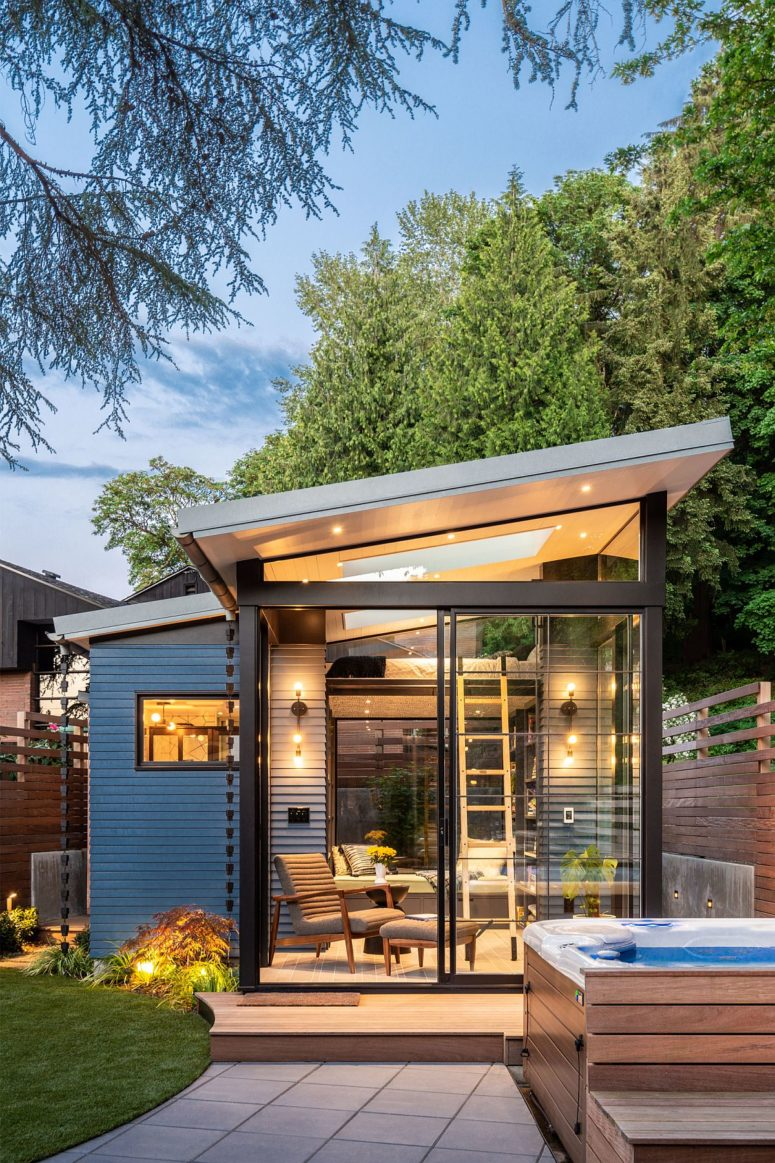 This ultra modern backyard shed has a small footprint yet several functions and zones inside, much light and storage
