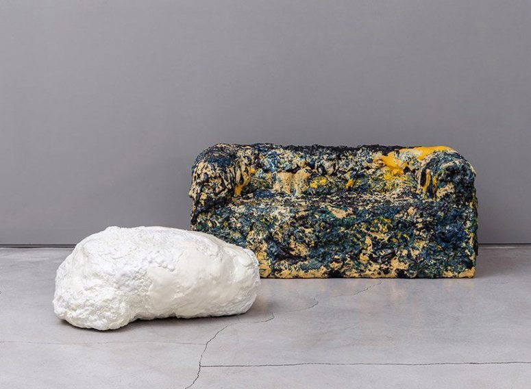 This unique foam furniture is inspired by meteorites and is painted bold to add impact to the space