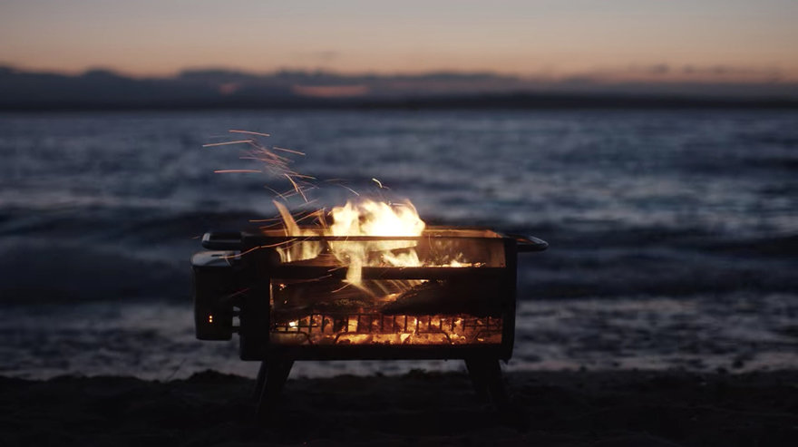 It uses wood or charcoal and is very effective plus there's less smoke than from a usual grill