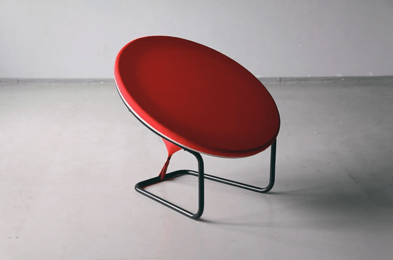 The chair consists of black pipe, red fabric and a seat itself