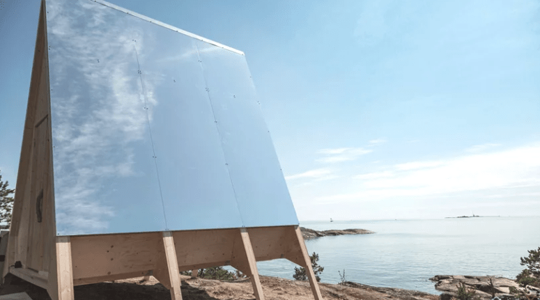 The energy is generated with these large solar panles, and the cabin itself is made of light-colored wood