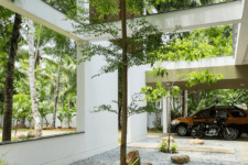 02 The house features contemporary architecture and decor and a series of garden openings with real greenery and living walls