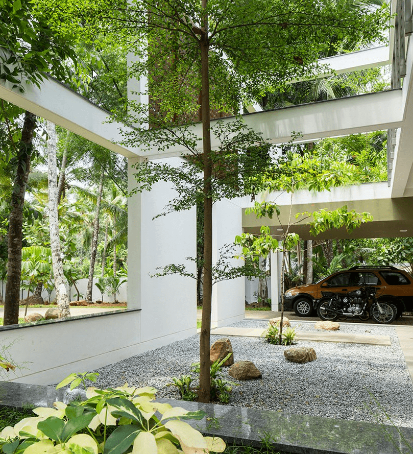 The house features contemporary architecture and decor and a series of garden openings with real greenery and living walls