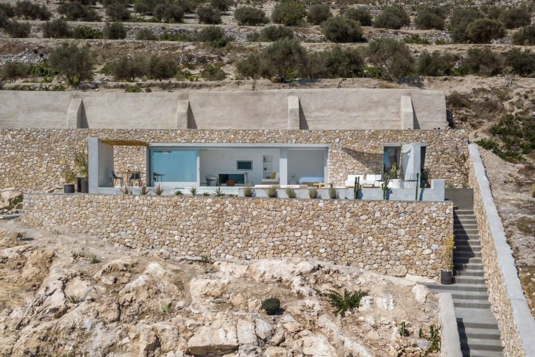 The house is built into the mountain taking as little footprint outside it as possible