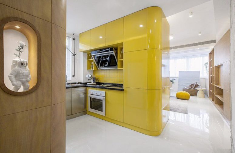 The main box is a bold yellow one, which contains kitchen cabinets and some built-in appliances