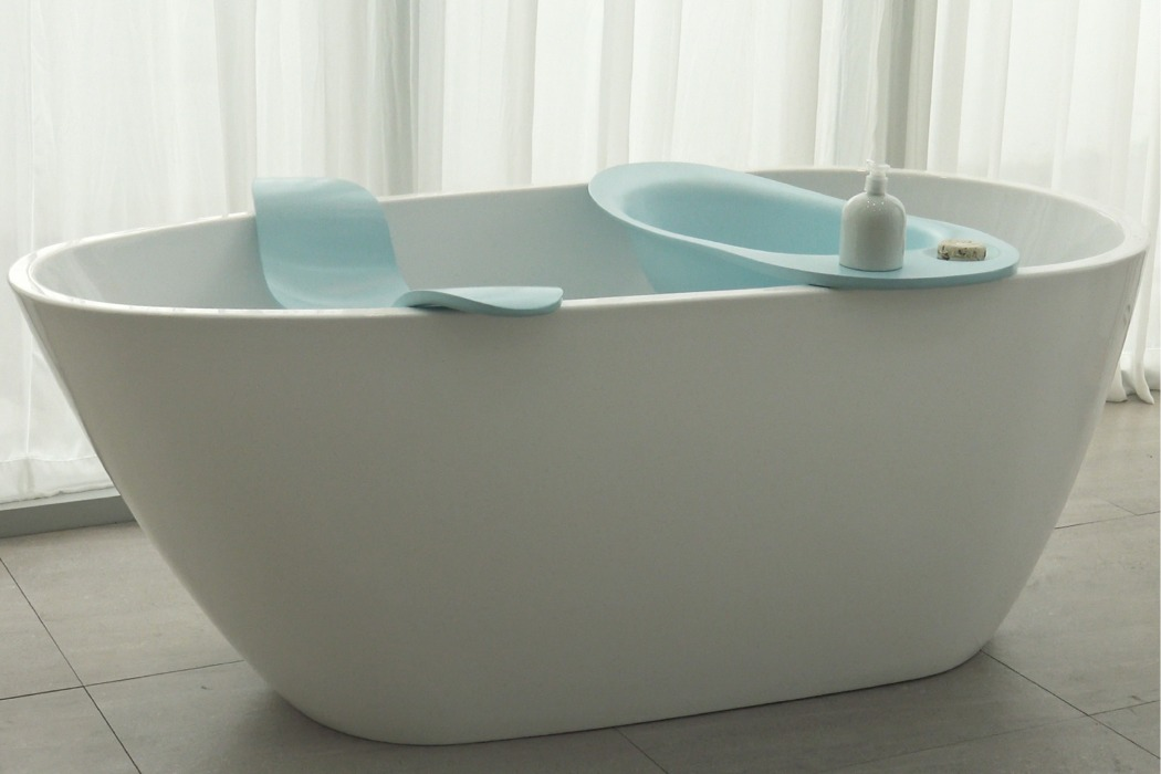 The piece includes a doggie tub with some space for storing soaps and a seat for the owner