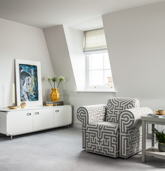 There attic windows and all the spaces are done in off-white to create a proper backdrop for bold items