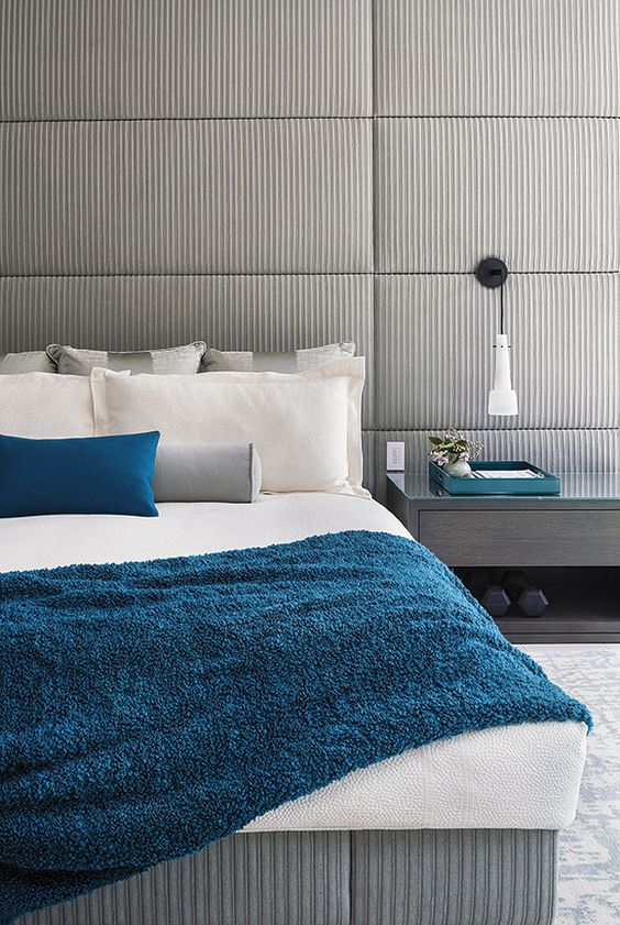 a grey bedroom with touches of blue and teal for a modern and a bit contrasting look