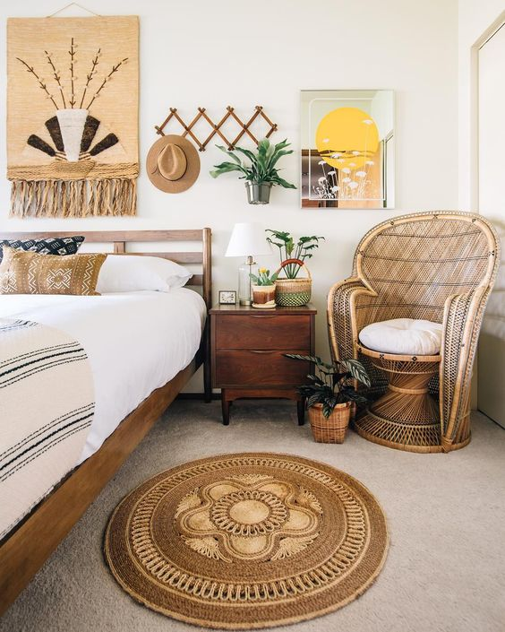 a jute rug and artwork with jute, a wicker chair ad some boho printed pillows for a relaxed boho space