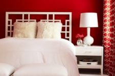 bedroom with red accent walls