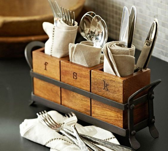 an industrial kitchen caddy with cutlery holders of wood and a metal frame in grey