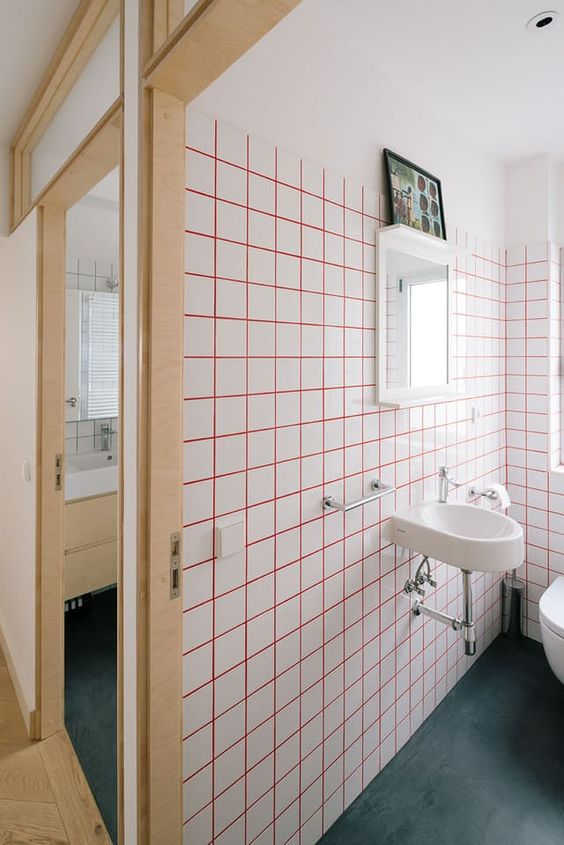 bright pink grout and white tiles for a modern and bold look in your bathroom