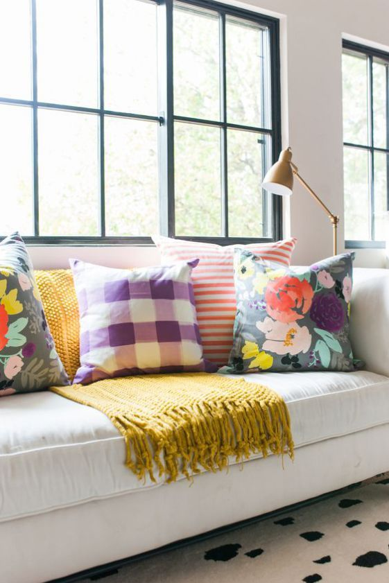 choose bright and printed pillows to elevate your plain room to a new level